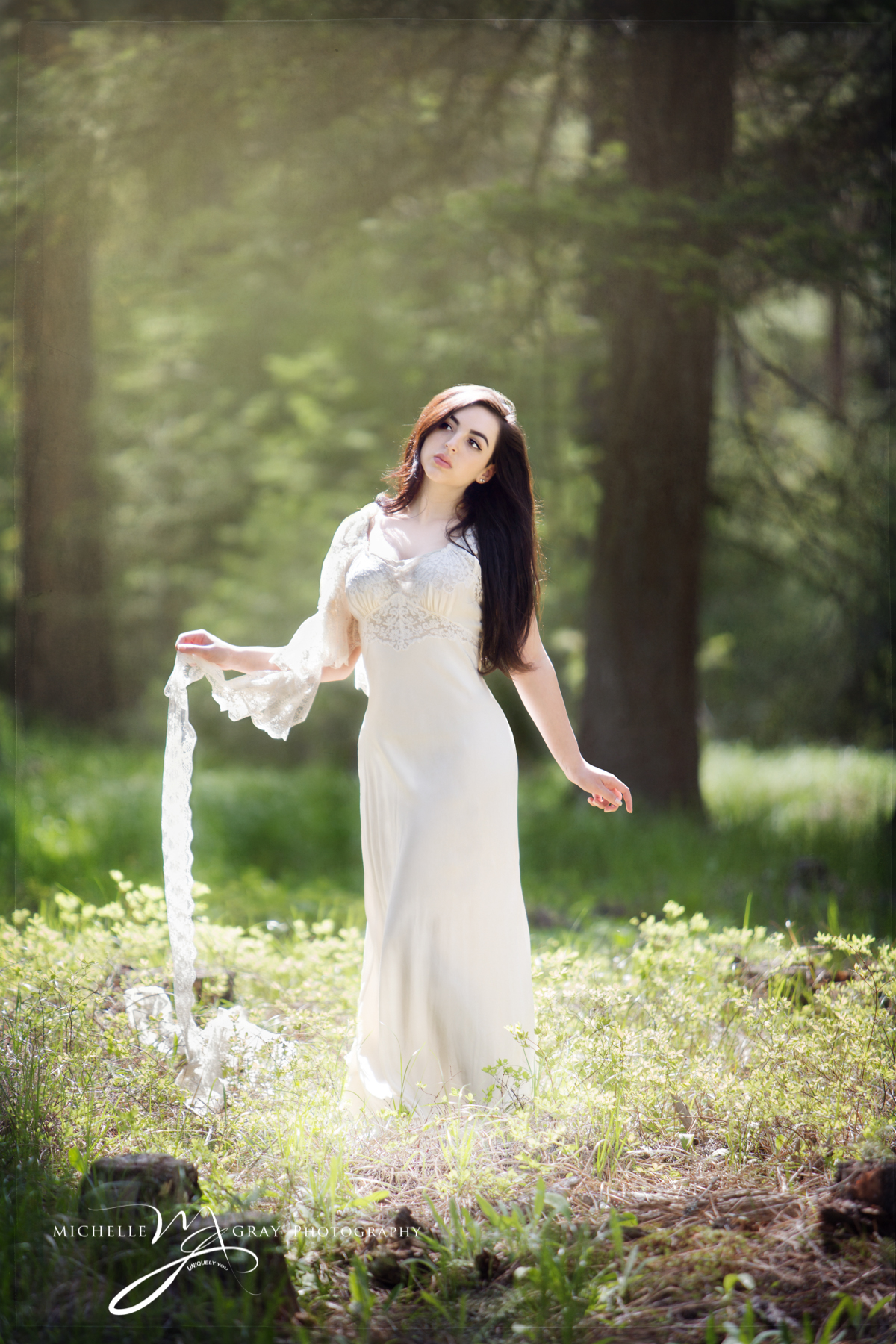 Fine art high school senior beauty portrait in a forest
